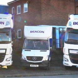 Beacon-Trucks-Outside-Building