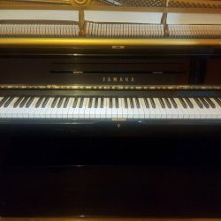 Upright Yamaha Piano in gloss black