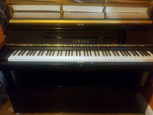 Upright Yamaha Piano in gloss black