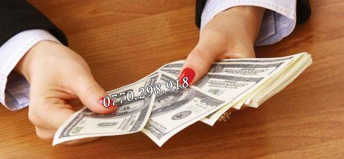 woman-holding-money-1725x810_13072